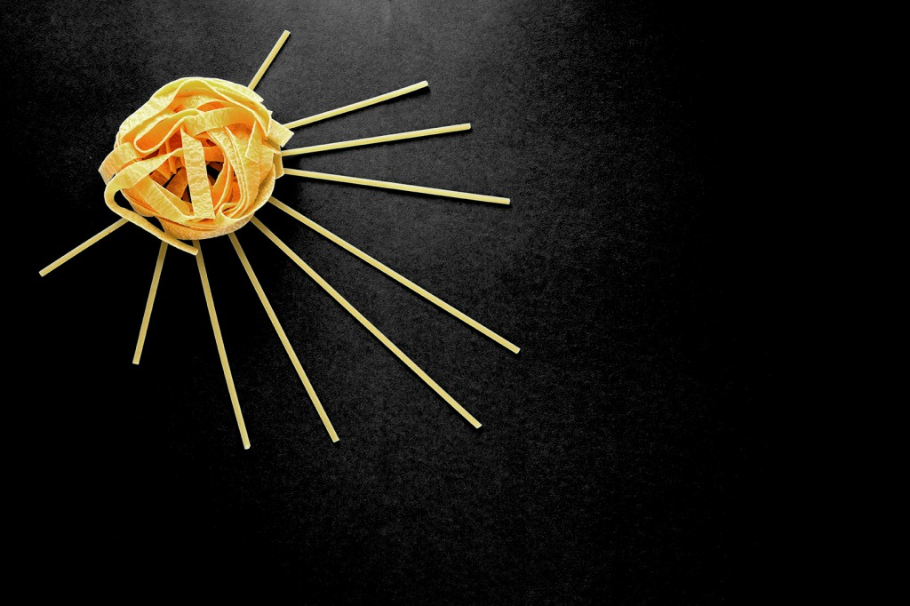 The Sun Of Pasta, Spaghetti And Fettuccine On A Blue Background,