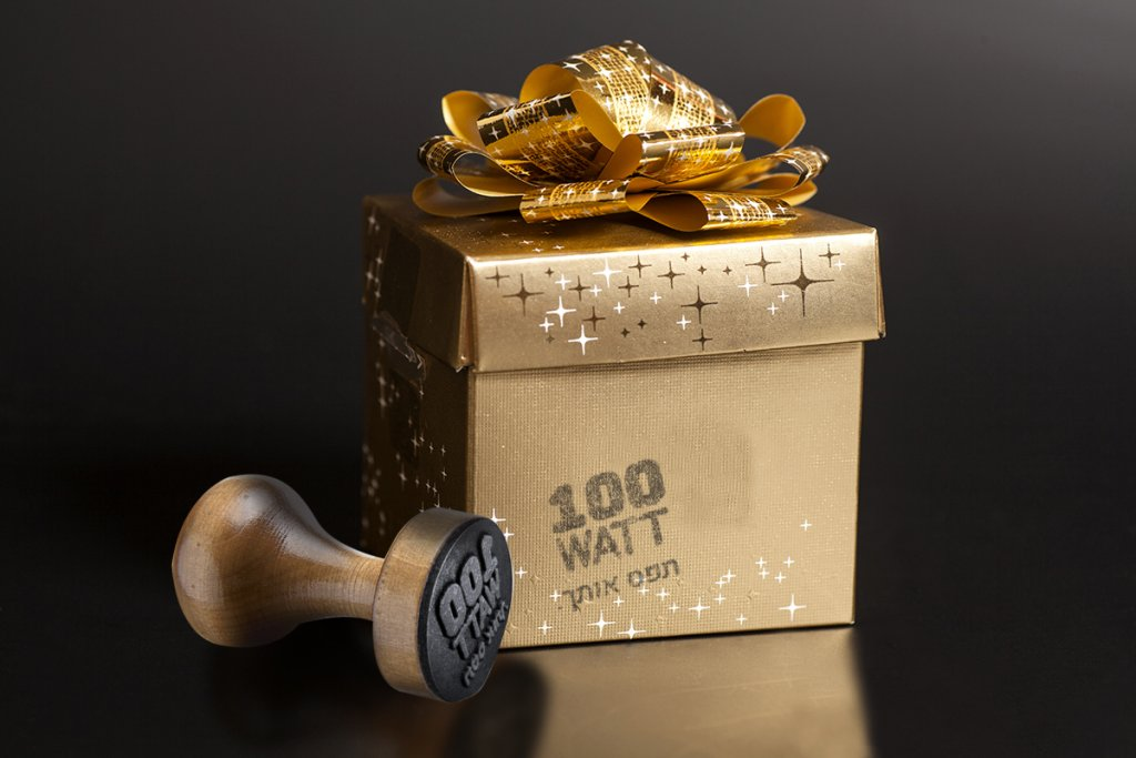 Golden gift box with golden ribbon on black background