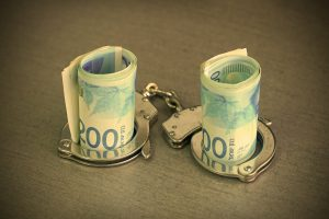Roll Israeli Money Bills (banknotes) Of 200 Shekel In Handcuffs.