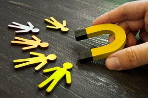 Retention Marketing Concept. The Manager Holds A Magnet For Cust